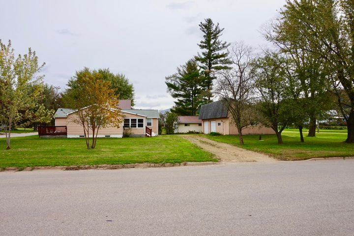 VERY NICELY SIZED CORNER LOT LOCATED ON THE OUTSKIRTS OF COON VALLEY.  BEAUTIFUL VIEWS OF THE VALLEY!  LARGE THREE CAR DETACHED GARAGE WITH CEMENT FLOOR, ELECTRICITY, TWO OVERHEAD DOORS, AND A LARGE WORKSHOP.  MANY POSSIBILITIES!