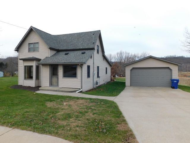 Well maintained 3 bedroom w 2 bath home with a large yard and a detached garage. New tile in entry!