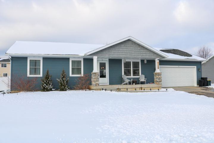 Newer ranch home built by Evenson in 2016! 3 bdrm, 2 bath with a beautiful open concept kitchen/dining/living. Basement finish out has been started with the intention of 2 additional bdrms (with egress windows) and a 3rd bath. Walls are up and some electrical completed. Large attached garage with extra storage space that enters into the mudroom/laundry on main. Patio door leads you out under the stout wooden pergola in the fenced backyard. Playset and fire pit are included!