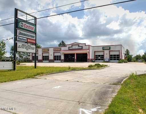 Back on the market!  Bank-owned and ready-to-sell!  Fantastic opportunity to buy a fully-functional auto repair/tire/oil change property.  Located on busy Hwy 57 for great exposure.  Price includes building and land only, equipment does not convey.  Full appraisal on file per request.