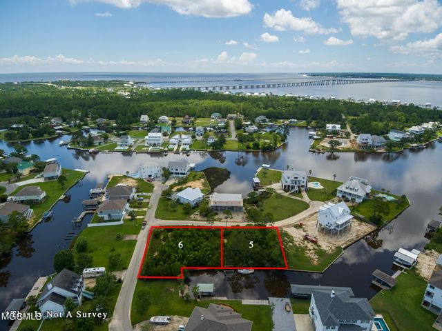 Beautiful Waterfront Lot. Photographs also show adjacent Lot 6 ( Locust Lane ) also available for sale . See MLS #378209