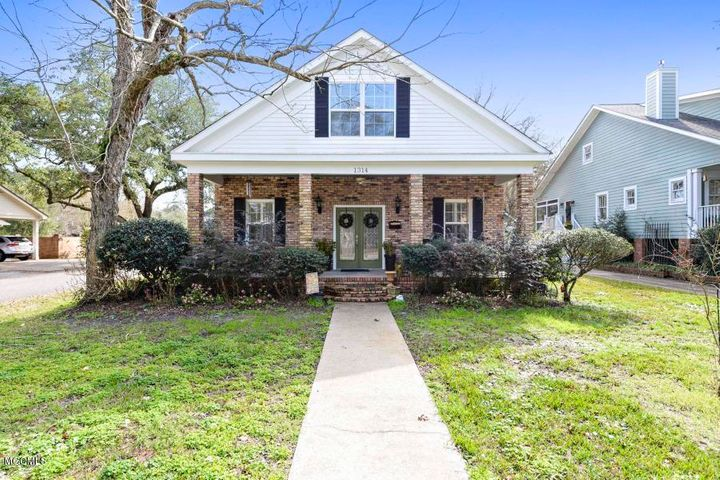 Absolutely beautiful home a block from the beach located with view of the Gulf from sitting room and in Beach Elementary School District.  You will be amazed when you step inside with all of the added touches of this home. Large eat in kitchen with double oven, formal dining room, family room and formal living room.  Master suite downstairs with custom master closet. Second bedroom downstairs with its own private full bath.  Must see this one of a kind find in great location in Pascagoula. Flood policy is transferrable and premium is $600/year.