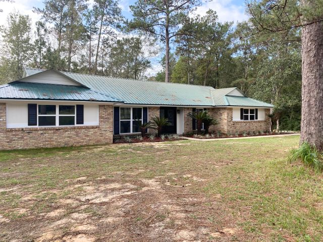 Absolutely Stunning! Completely updated 4 bedroom 2 1/2 bath in East Central School District on 1.60 acres with storage shed with lean-to.  Open floor plan with large kitchen/dining/living room.
