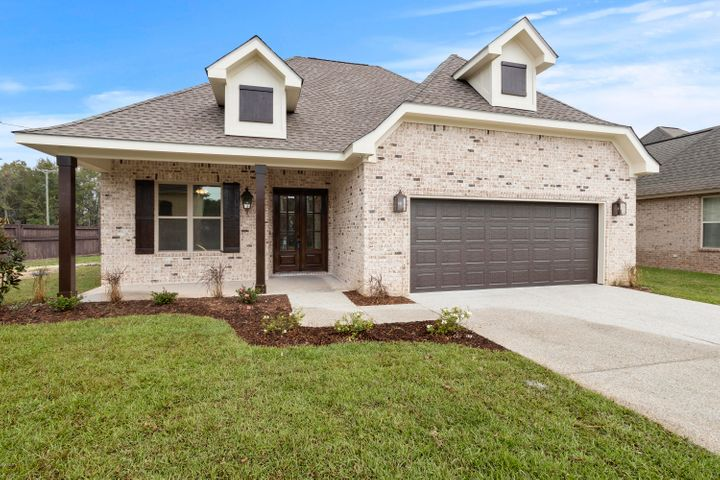 Stunning custom home in OCEAN SPRINGS SCHOOL DISTRICT in gated Acadian Village Subdivision.  Light and airy.  Gorgeous details throughout.  Beautiful brick and shiplap accent fireplace wall in great room.  Granite counters.  Stainless steel appliances.  Gorgeous fixtures.  3 Bedrooms, 2 bathrooms.  This home is a MUST SEE!