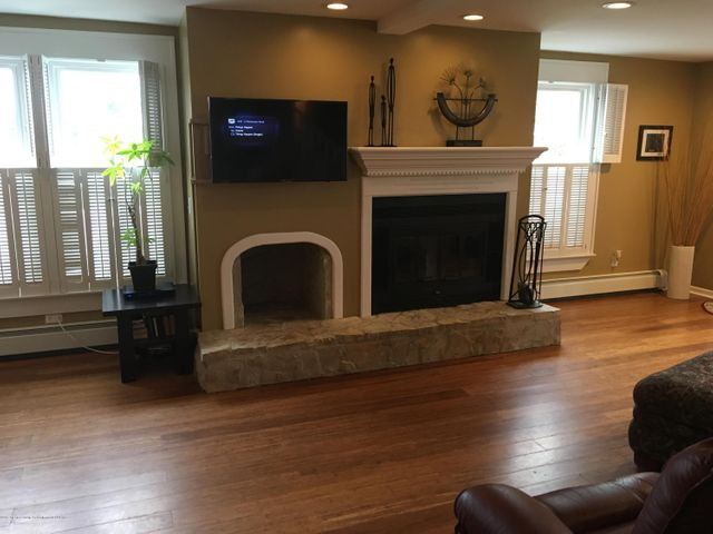 1422 W Cutler Rd - Living Room w/ Wood Burning Fireplace - 2