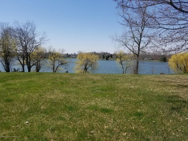 Spectacular Rare Opportunity! All Sports Lake Front Lot waiting for your Dream Home!
