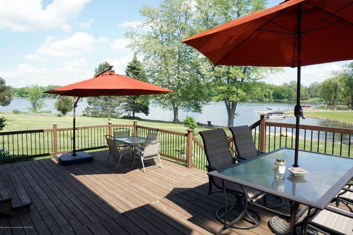This could be your view! Professionally built, newer deck. with 2 tiers and steps down to the back yard and beach!