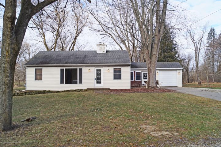 Updated 3 bedroom ranch on over an acre in Okemos close to the Meridian Mall with a stream on one side and a park across the street.