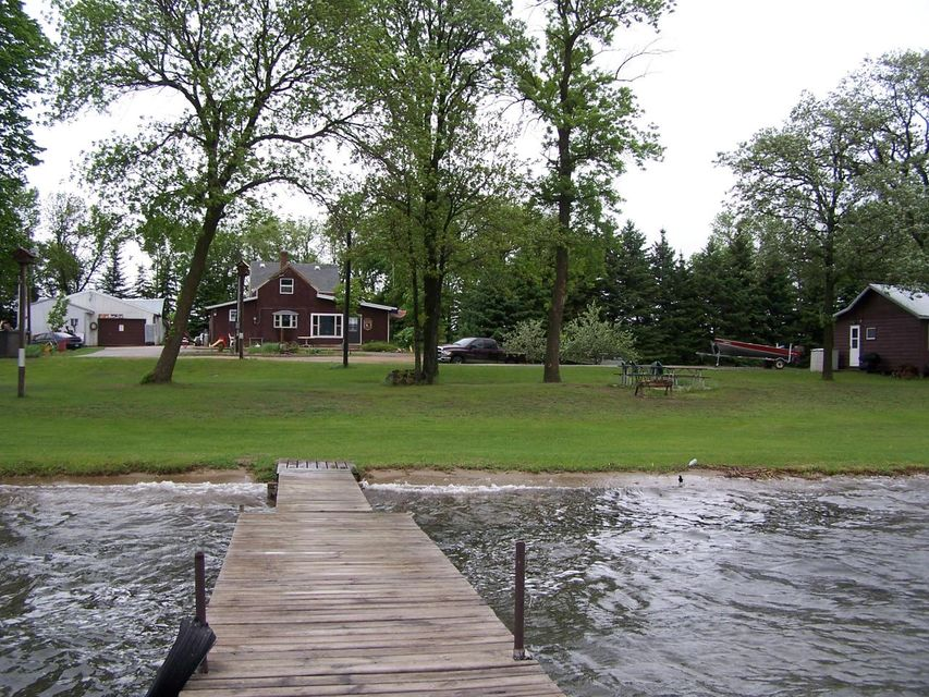 240 feet of sandy level shoreline. Top that off with the inlet stream from lake Miltona are what make this featured property a one of a kind. Lake Ida is over 4000 acres in size. Having one of the highest water clarity ratings of the county. Home and summer cabin. Realtor is related to sellers.
