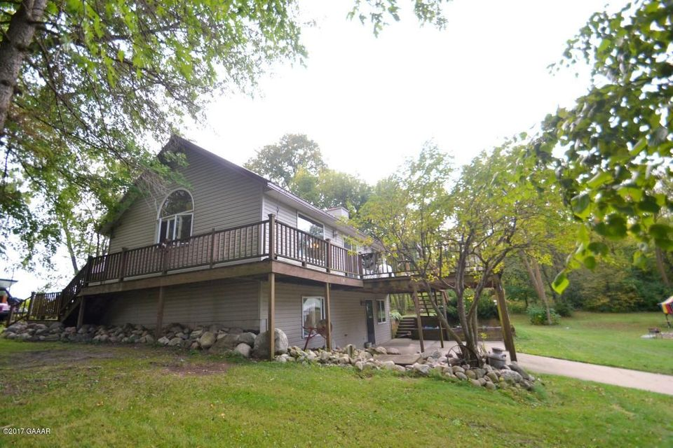 Hobby Farm on tar road one mile past Miltona Golf Course.  Beautiful acreage, 3 bedroom, 3 bath home.  Outbuildings and great hunting! $2,000 deck allowance.  See Supplement for details.
