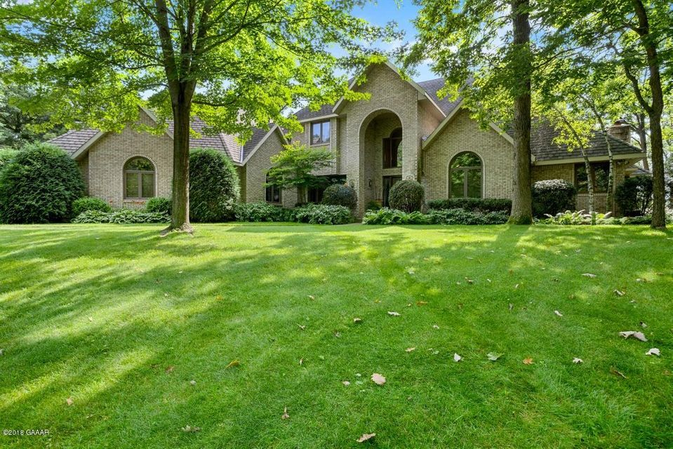 Classy, Executive Brick Home on Lake LeHommeDieu.  Beautiful private 1.61 Ac lot with 140' perfect elevation & riprapped shoreline.  This 2 story, all brick home has 4 bedrooms; 6 bathrooms. Great floorplan for entertaining inside and out w/cedar deck, pavered patio & outdoor kitchenette for bar-b-queing.Marvin windows provide great lakeviews.  3 car garage for good storage. See numerous features on the Feature Sheet under ''documents'' Also see Virtual Tour under ''photos''