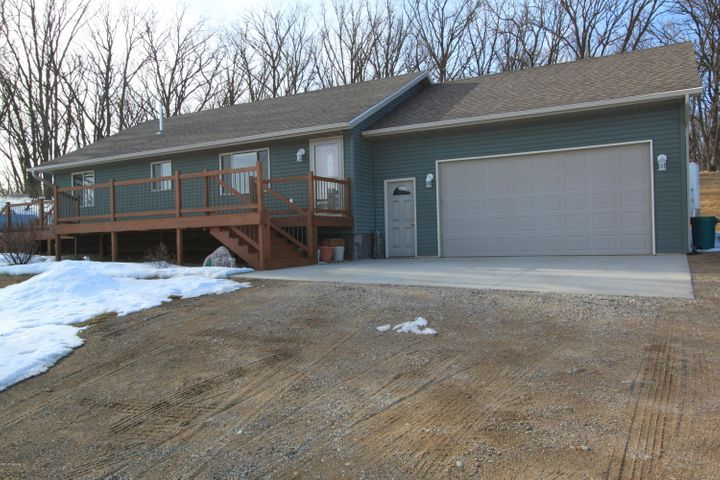 Front view, large deck and deep 2 stall garage