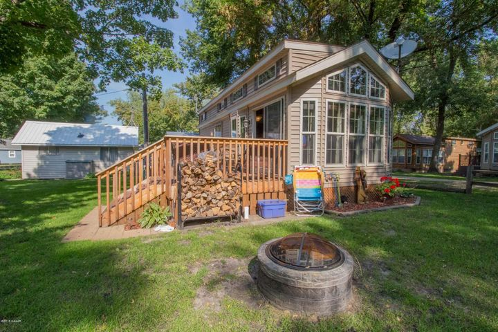 Beautifully Landscaped Yard, Newer deck, close proximity to the lake. Fire ring.