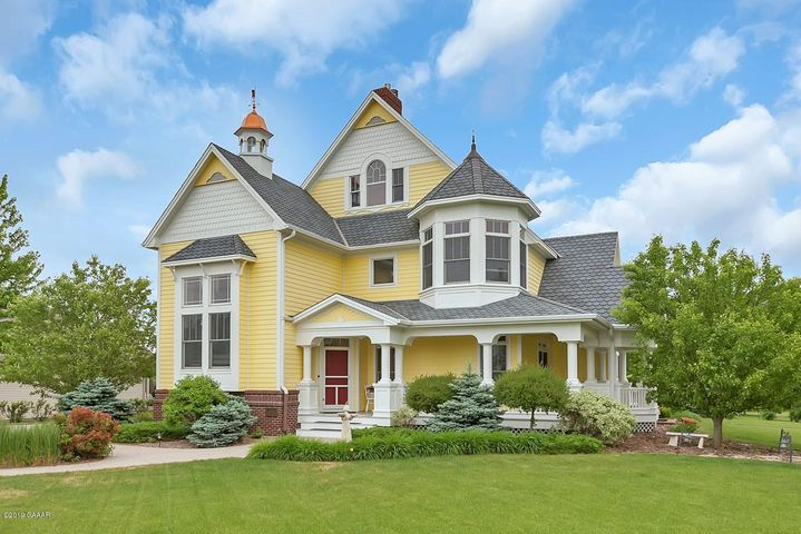 Welcome to 325 Highland Blvd, an architect designed Queen Anne Victorian style home with a wrap around front porch and copper-topped cupola with weather vane.