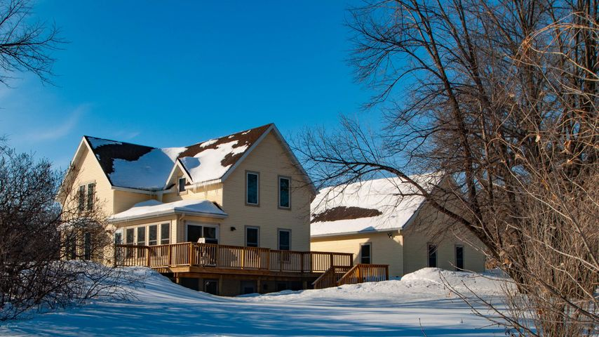 Currier and Ives setting offering 5 acres close into just about everything. You will find a beautiful home on Lake Winona and room for pets and kids of all ages to roam. Make this your next home!