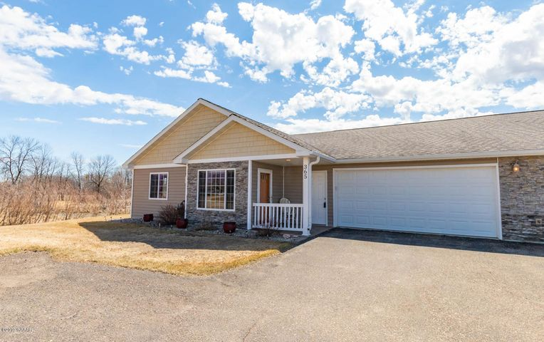 End unit offers 2 bedrooms, 2 baths, living room with fireplace and a 4 season room that will be the place to be! Check out this end unit with a pond view!