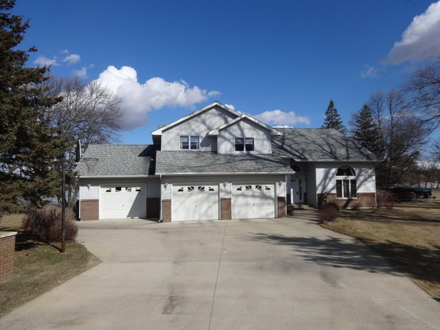 Chain Access at Affordable Price! Plus $3000 appliance allowance!  Level to the lake on Geneva with .46 acres and 95' frontage.    Immaculate 3 BR 3 Bath.  Many upgrades in recent years.  See list under ''supplement''.   You'll want to spend many moments in the ''sunny'' sun room overlooking the lake.   Entire cedar vaulted ceiling replaced in 2018.    Galley kitchen with wonderful center island is great for cooking or entertaining.  Large 12 x 30 lakeside deck also great for entertaining.  City Sewer in and paid; city water has been brought into home for future hookup if wanted.   Easy access and close to Lk LeHommeDieu beach plus remaining chain. See Virtual Tour under ''photos''; Then click ''home''