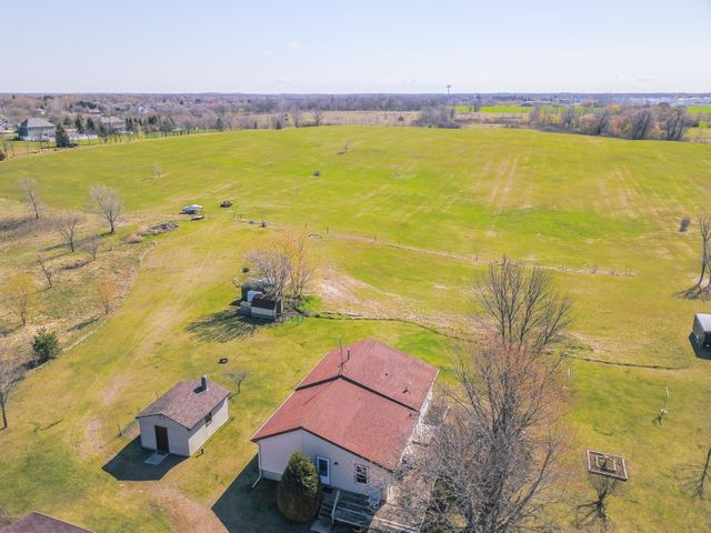 Beautiful property!  28+ rolling acres with tons of wild life.  Property is within walking distance to Lake Cowdry public access, Central Lakes Bike Trail and YMCA.  Nice 4 bedroom 2 bathroom rambler with large living spaces.  Finish off the basement for even more space!  This would also make a beautiful spot for a development!