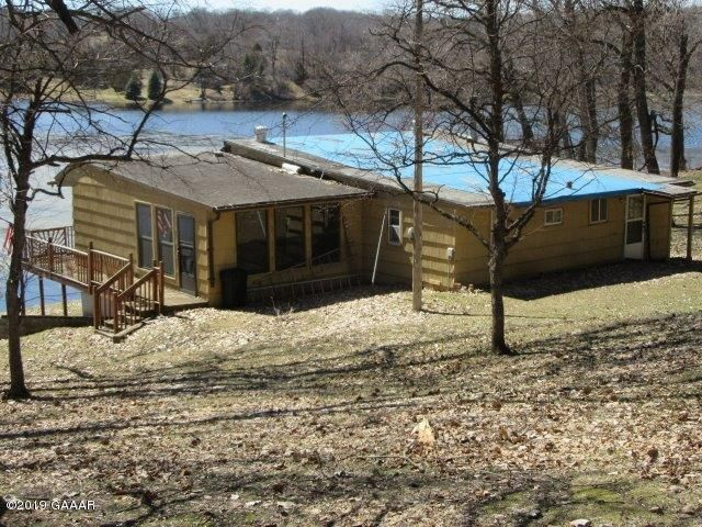 3 Bedroom cabin by the lake, plus a detached 3 car garage with 2 bedroom cabin area above it to be finished,  Sold ''AS IS'' 133' of Lake Shore - very private.