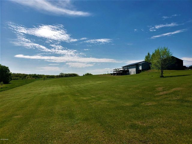 Country Living, Wide open spaces, Home on the range....? If any of these phrases gets you excited you need to come and see this economical self sufficient country home on 24.36 acres just 10 minutes from I - 94 near Sauk Centre. 3200 sq ft 3 bedroom 3 bath walk out rambler with a partially finished lower level on Ashley Creek with a 50' X 92' heated shop, a 32' X 92' lean tu, & a 30' X 45' wood shed. Home and shop are both heated by an outdoor Brute Force 8150 wood burning boiler system capable of logs up to 5' in length. Current owner runs a trucking business at this location. Seller to provide finishing touches to the home & lean-to.