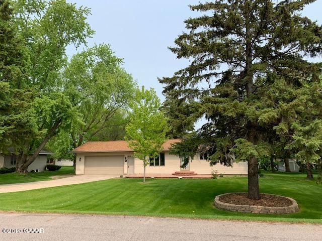 Built in 1974 here is a beautiful 4 bed 1.50 bath Rambler Style home on a large .34 acre lot across the road from Meadowlark Country Club in Melrose. Property features: Wooded lot, Private Deck in backyard, Fire pit, two storage sheds, 23x24 Two car attached garage w/ attached 14x18 workshop/storage area in addition to the garage, underground sprinklers, Front yard Patio. This home also boasts 3 main level bedrooms and finished lower level. The whole interior has been painted, new flooring and appliances.