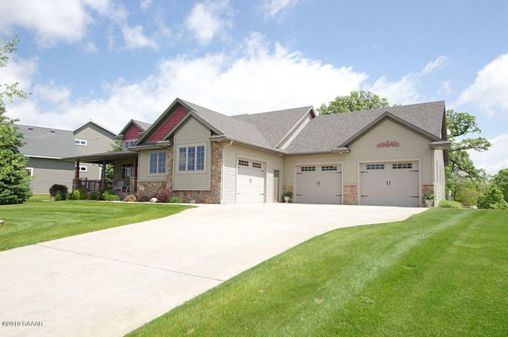 A MUST SEE OUTSTANDING CUSTOM BUILT HOME ON GENEVA GOLF COURSE   BEAUTIFUL NATURAL SCENERY  THE FEATURES IN THIS HOME ARE TRULY REMARKABLE  HIGH QUALITY DESIGNER LIGHTING  ALONG WITH STUNNING BUILT-IN CABINTRY THROUGHOUT   LAUNDRYFACILITIES ON BOTH LEVELS