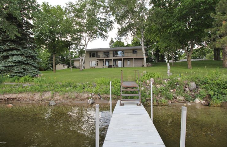 Enjoy Peaceful Lake Living & 349 feet of lakeshore on Lobster! Beautifully landscaped and level shoreline with sandy beach is situated on almost two acres of land with private road! This homes features a Generous Open Floor Plan with lake views from the Kitchen and living rooms, Gas Fireplace, main floor bedrooms, main floor laundry and beautiful remodeled bathrooms with walk in tiled showers.  Windows Galore to enjoy the Panoramic Views & a Lower Level that won't disappoint! Great Room for entertaining, bedroom, and multiple storage areas, Mechanical room complete with new Trane Furnace!  Relax on your maintenance free 10x40 aluminum deck or stroll out to the lake from your walk out basement. This property is a must see, ~ Never listed before!  2 car attached garage and tuck under garage