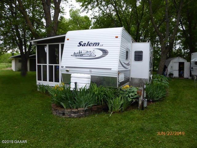 Well maintained Salon RV 2005. 2 bed, + foldout couch, enclosed deck, has fold out.  Winterized every fall, shed + tools. Association has water softner system, fish cleaning room,  laundry with public bathroom, 2 playgrounds, wonderful beach area and sunrises.