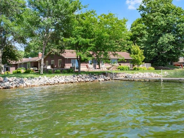 Prime location on Lake LeHomme Dieu on Alexandria's Chain of Lakes! Lots like this are rare to come on the market! Large 5BR/3BA one level home on 414' of level shoreline with lake views from almost every room in the house! Super sized attached & heated garage...40'x30'...with boat rails for 2 boats allowing for interior storage of your boats...no lifts required!! Wrap-around raised paved patio for outside enjoyment plus maintenance free private patio off lakeside master bedroom.  No basement, but tons of storage closets in this home. Please enjoy the virtual tour!