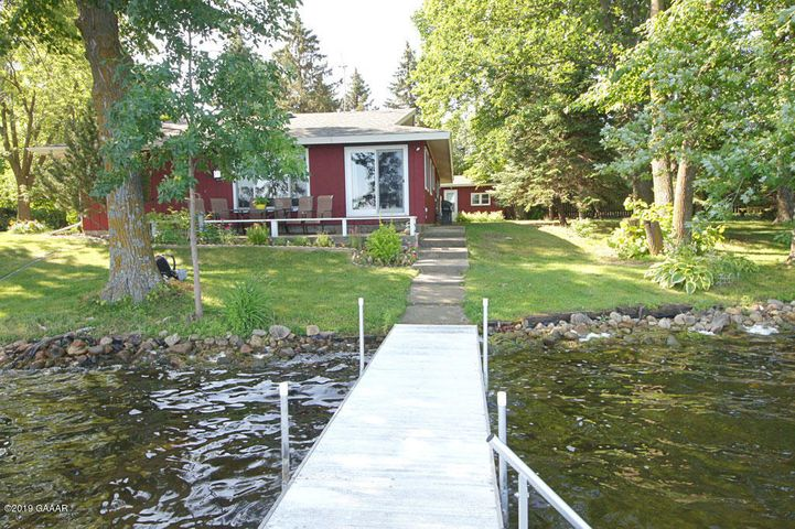Charming 3 bedroom lake home with 254' of sandy, level shoreline. The .5 acre wooded lot provides privacy, shade on hot summer days and is beautiful in the fall. The interior features hardwood floors, a gas fireplace, new windows,main floor laundry, a great kitchen and every room has been tastefully updated. The detached garage can easily double for extra sleeping or a great place to get away during the summer months. In the winter it's great storage and to park a car.  The shoreline is sandy and there is easy access to North Union Lake, Stoney and Taylor. The home comes partially furnished. See documents for what is included.