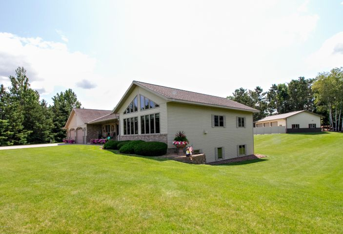 Premier custom built Rambler on 2 acres just north of Sauk Centre between two golf courses and close to Sauk Lake public access! This place has it all. Spacious open floor plan! Beautiful oak woodwork throughout. Multiple pull outs throughout kitchen. Hardwood flooring, Large main-floor master bedroom with walk-in closet, Main-floor Laundry with amazing storage, In-floor heating, Hot tub room and craft/hobby room in nicely finished basement. Huge utility room with extra storage, 6x30 storm shelter / fruit cellar. Steps up to 4th garage area from basement. Irrigation System, large parking area behind home with space for multiple RV's or additional parking. Nicely finished 30x50 heated and cooled shop with office and bath and security system. Additional storage buildings behind shop.
