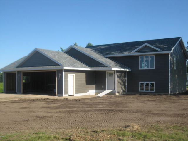 New Construction in process - Great location near the public boat access on East Lake Ida, .56 acre lot, finished 1128 sq ft, 2 bedroom, 1 bath, 3 stall garage, custom cabinets and many other quality features. Lower level finished would add 2 additional bedrooms and 1 full bath. Sale Price would be at $289,000 completely finished.