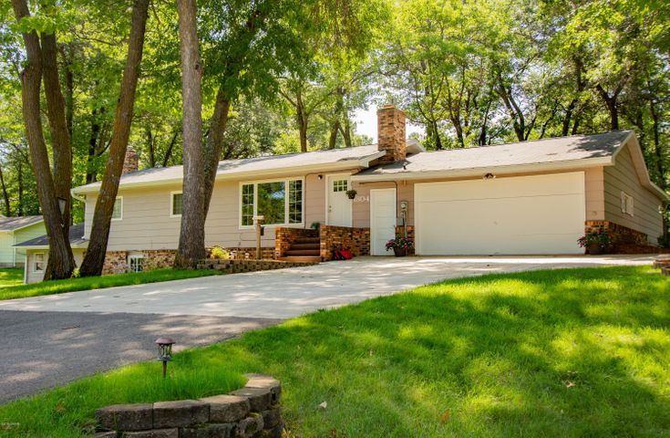 Come check out this large family home nestled in a grove of mature trees that has been completely updated, not much of this home has gone untouched. The kitchen comes with real hickory floors and cabinets and is loaded with natural light. The family room features a fireplace framed with brick that is complimented by ship lap ceiling. The master bedroom is big and has a huge walk-in closet.  The downstairs is sure to please. It's a great place to cozy in and enjoy a movie, entertain with a game of pool. (the basement is plumbed for a wet bar). It offers another fireplace, two more bedrooms and an office. If you are a back yard enthusiast, this is a must see. There is a basketball court, fire ring and two tier deck and patio that offer endless enjoyment.