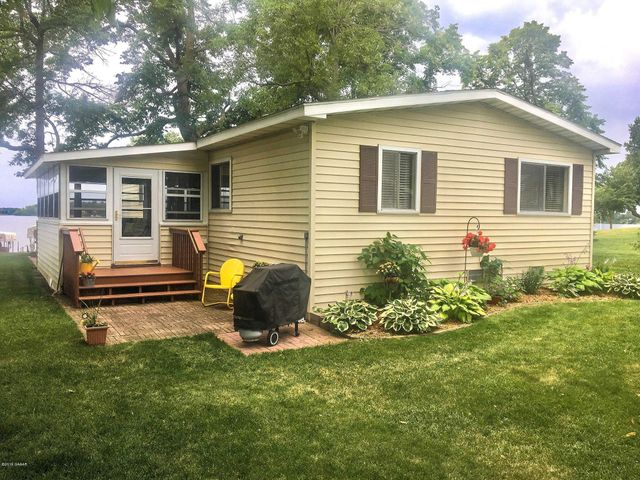 100' Level Lake Ida facing south. This property is being sold with 2 parcels. Home is 40 years old modular home in excellent condition and has a very nice porch. Come take a look for yourself, you won't be disappointed!