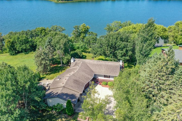 Lake life is best when on Lake Burgen. If you are looking for the ultimate swimming beach with hard, sandy bottom check out the beauty that Burgen offers. If you're looking for a lake place that has privacy and ultimate lake living, you need to come check out this home. Featuring an updated kitchen, granite counter tops, open floor plan, awesome mudroom/laundry room, big three stall garage, and walkout basement. If outdoor living is your thing, this home resonates of indoor/outdoor entertaining with a big wrap around deck, lots of yard to live in and play. With the loads of mature trees for lots of privacy which creates the perfect nature feeling walk down to the lake. Make your next home a lake home on Lake Burgen.