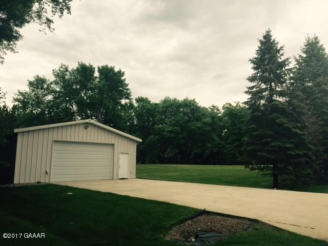 You will love this spacious lot to build your home or have extra breathing room with this 30 x 45 shed, great storage for your boats,cars and toys -  driveway and inside building cemented. Property has city sewer and water hookup available, dumping access for recreational vehicle. .50 acre corner lot