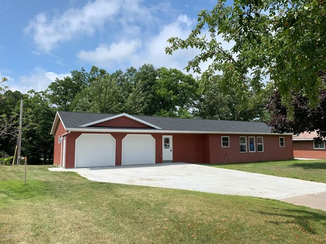 Built in 1958 here is a completely remodeled inside & out 4 bed 1.50 bath walk-out rambler on a Wooded .28 Acre Lot. Property features: New Windows, siding, roof, Kitchen Cabinets, counter tops & fixtures.
