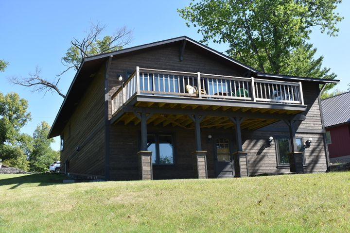 Lake Ida walkout with beautiful south facing, sweeping views. This adorable ''cabin like''  year round home has had everything replaced plus a new addition with full basement was added in 2017. The very large lakeside deck was replaced in 2018. The siding, shingles, main floor windows, front door, lakeside door were complete in 2018. Future owner will have the opportunity to finish the main floor bath and install flooring. That is basically all that is left to be done. Garage and lot across the road is part of the property and is included. New furnace (heat  pump) electric and gas plus central air new in 2004. Home has an open feel and 2 fireplaces. What a great place to relax and enjoy the peace and quiet.