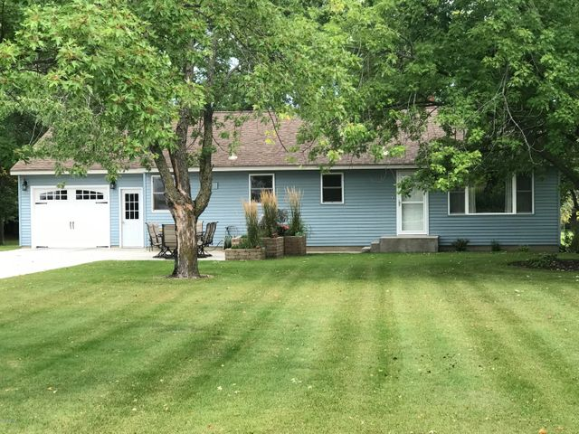 Lots of recent updates on this spacious 3 bedroom rambler on the edge of town.  Beautiful mature trees.  In 2017 newer windows, siding and home was insulated.  A water treatment system was installed. Attached garage is heated and insulated. There is also an extra detached garage that is insulated. Well has a new pump. Close to bike trail on a nice wooded large lot.