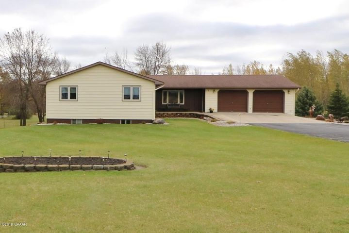 This is a BEAUTY of a setting! Immaculately kept 5BR, 2 1/2 BA Rambler situated on 1.9 Acres! Mainfloor features 3 BR's Spacious Living Room, 5 year old thermotech windows, 2 stall attached insulated garage, wide hallways, ABC seamless steel siding. Downstairs, all new flooring, 2 BR's, 1 Full BA, beautiful stone fireplace, tons of storage, additional room perfect for a rec area, walkout to the patio and take in the view of the backyard and beautiful flower beds. Tuck under garage in the back of home for additional storage. Dreaming of that Man Cave? There is plenty of room to add it here and the approach is already in place. There is a ton to offer with this home, come and see today! Conveniently located close to Alexandria and Interstate.