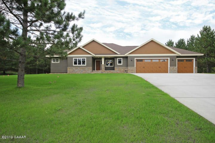 A home designed for a family, Custom designed home built for the Tour of homes in 2016. Lots of upgrades, details and extras in this home.  Current owner added a 4 season room, storage shed and firepit area. Spacious bedrooms with built in's (shelving and storage)  Two Fireplaces, lower level has large lookout windows with nature view of the large 1.55 wooded lot.  Heated 3 stall garage.  Looking for a home with lots of elbow room this is the one approx. 4174 sq of finished space. Main floor has 3 bedrooms, 2 with Jack and Jill bath...large owners bath with walkin shower and closet....lower level has 2 additional bedrooms...Many detailed extras and a custom designed kitchen. Exterior of the home has the new Smart Board siding.  This home is loaded with many extra features.