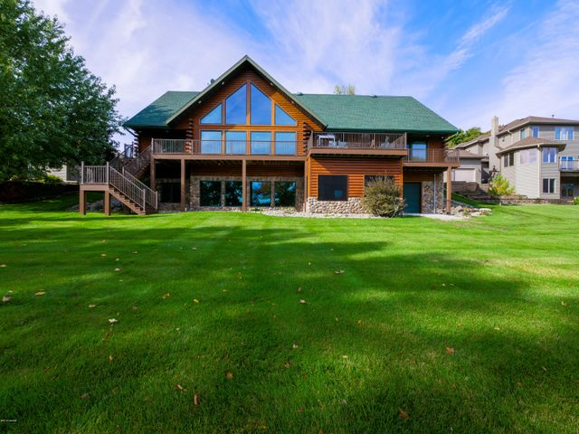Up north charm on the west side of beautiful Lake Carlos on the fabulous Alexandria Chain of Lakes. This log home boasts 5 bedrooms and 3 bathrooms all nestled on 1.29 acres with 100' of lakeshore. Main floor is comprised of 36'' doors for ease of accessibility.  Two gas fireplaces and in-floor geothermal heat. Walk-out basement features a kitchenette, a large family room, sewing/craft room, and a recently constructed screen porch. Three car garage plus a large lower level storage area with overhead door on the lakeside for all your 'extra' toys. Paver patio by lake. New carpet in 2015. New appliances and shingles in 2016. New granite countertops in 2018. New deck in 2019. Home is being sold furnished, so grab your clothes and toothbrush and get ready to relax.