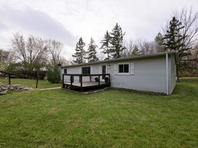 A short walk away from Latoka's public beach sits this recently updated manufactured home on a half-acre lot. With a fresh update, this home is ready for you to move in right away! Featuring three bedrooms, two bathrooms, and an open layout providing great natural light to flow through the home. Dual heat sources allow you to decide the most cost-effective heating solution between electric and propane. Decks on the north and south sides of the home allow for great outdoor seating! A great start to home ownership begins.