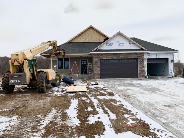 Very nice 4 bedroom, 3 bath newly constructed home featuring main floor laundry, gas fireplace, large family room, awesome kitchen, triple garage.  Irrigation and the lawn will be completed in the spring.