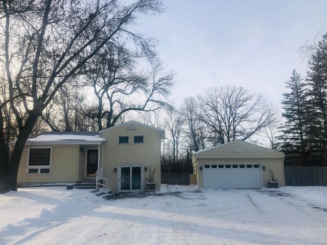 Great opportunity to be close to town and still have a country feel. This split level  home features many updates, 2 bedrooms, 2 bathrooms, large deck overlooking the fenced in yard. Maintenance free exterior siding on the home and oversize garage   with a workbench area and room for 2+ vehicles. Call for a showing today!