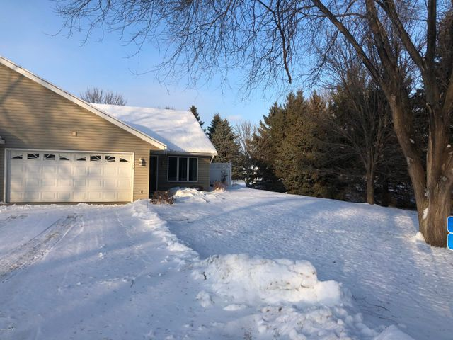 Very nice twin home with maintenance free living.  Close to town, this one level home comes complete with custom cupboards, main floor laundry, walk-in closet, 4 season porch, two-stall garage, and a storm shelter with room for storage.