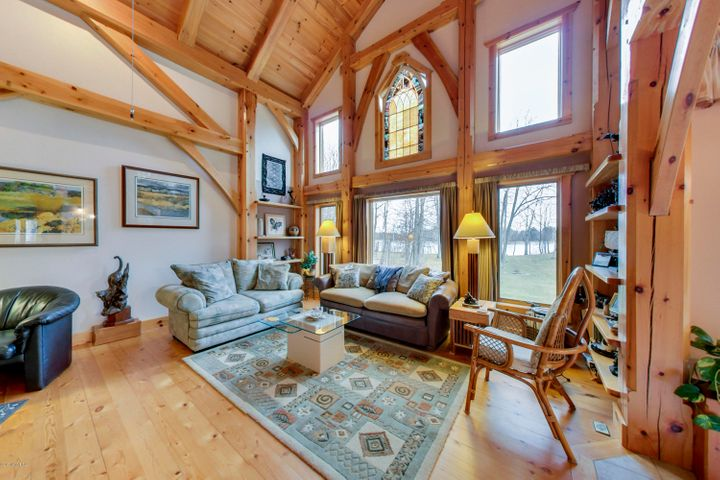 Custom Timber Frame Home, providing old world craftsmanship in a new world home. Designed & constructed by an industry acclaimed builder. A true work of art accented with a stained glass window and a ceiling peak that looms 27' above the Great Room floor.