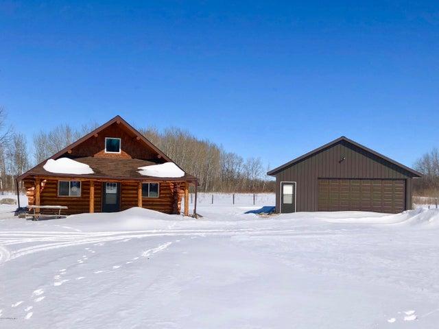 Log cabin and garage on 2.5 acres
