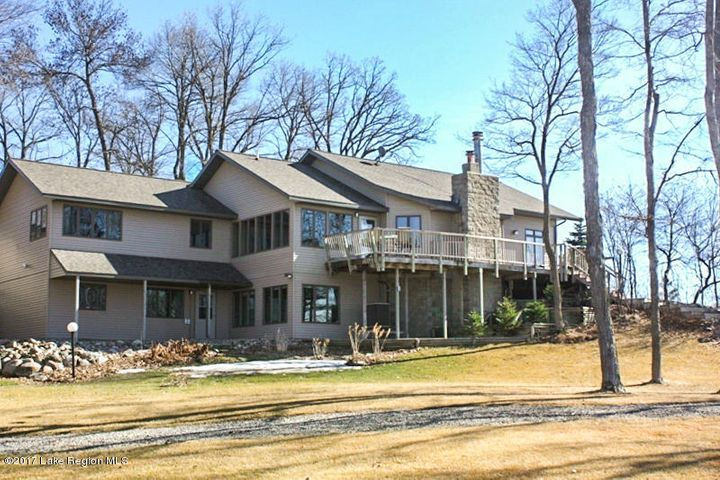 Lake front on Little McDonald and Kerbs Lakes make this home special! Lake views from every room in the house! Updates throughout this home make for a welcoming, spacious and relaxing atmosphere.