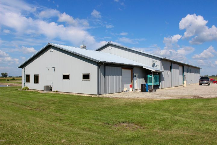 109' x 60' (w/2 14' Overhead Doors) PLUS 48' x 40' for 2 offices, conference room, 4 horse stables.